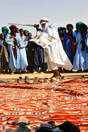 Tuareg man dancing in ceremony with sword (click to enlarge)